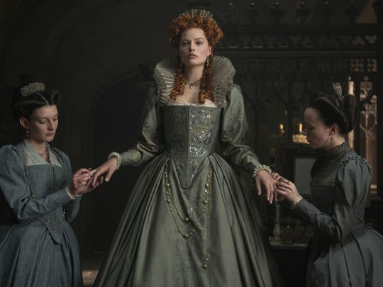 "Margot Robbie (center) wears the crown as Queen Elizabeth I in ""Mary Queen of Scots"""