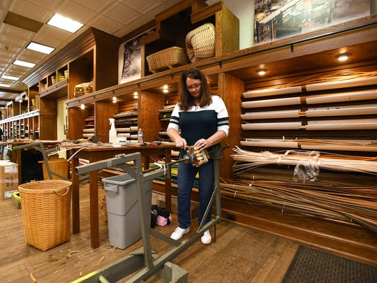 Mary Senter, who has been with Longaberger since 1981, weaves a basket in the new Longaberger's Patio Shops on Main Street in Dresden.