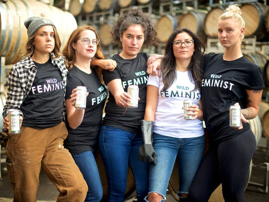 Young women hold cans of Union Wine Co.'s Get It Girl