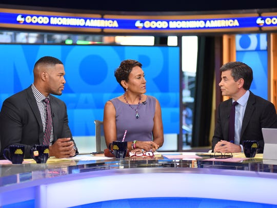 Michael Strahan, left, Robin Roberts and George Stephanopoulos