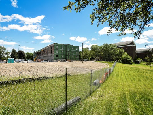 All three housing projects at the former Michigan School for the Blind campus on the city's north side are expected to be completed by the end of 2019.