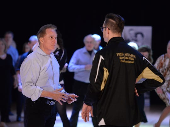 Keith Famie talks with dance instructor Donald Westphal