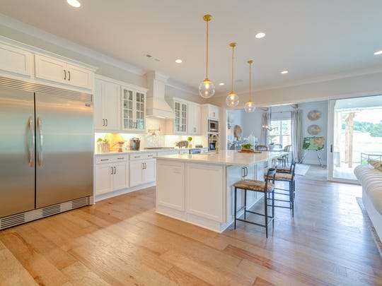 The model home in McDaniel Farms is open to the main living area and features a massive 66-inch stainless refrigerator, which comes standard.