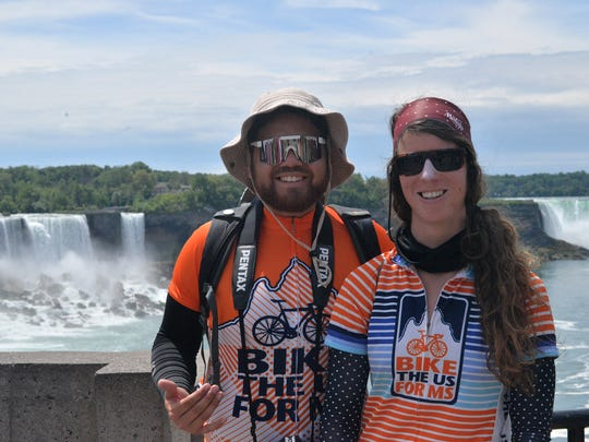 Claire Dal Nogare and a fellow rider at Niagara Falls. Dal Nogare, a US Park Ranger in Everglades National Park, is biking 11,000 miles around the U.S. to raise funds to fight multiple sclerosis.