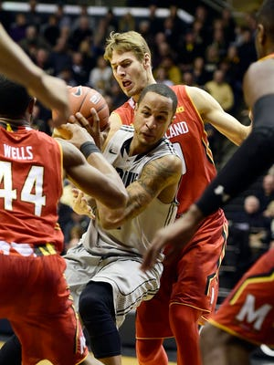 Jan 10, 2015; West Lafayette, IN, USA;Purdue Boilermakers forward Vince Edwards (12) gets trapped between Maryland Terrapins guard/forward Jake Layman (10) and guard/forward Dez Wells (44) on a drive to the basket during the second half of the game at Mackey Arena. the Maryland Terrapins beat the Purdue Boilermakers 69 to 60. Mandatory Credit: Marc Lebryk-USA TODAY Sports