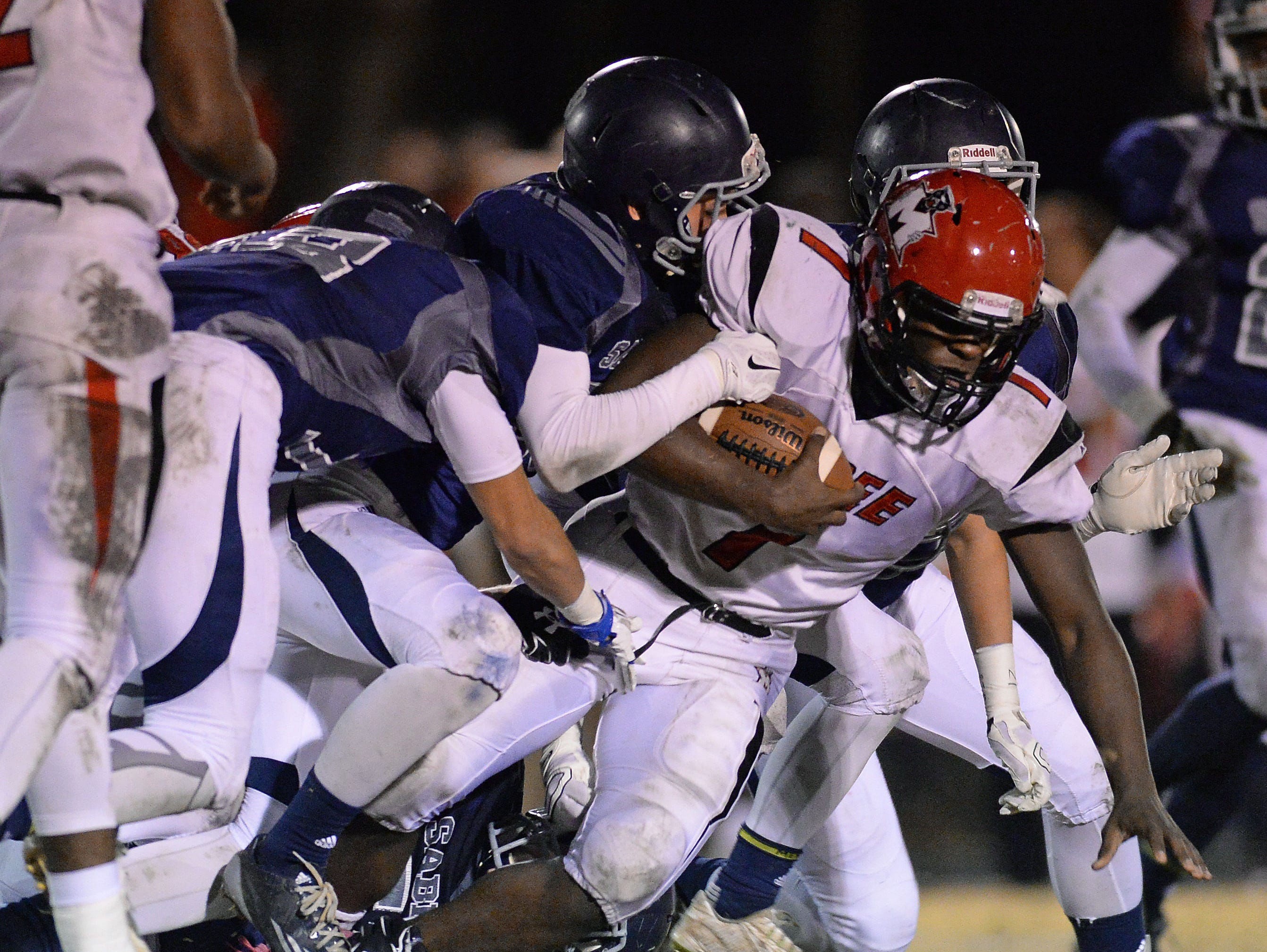 McBee's Dashonnell Wright (7) is brought down by the Southside Christian defense during the Class A Division I playoffs Friday, November 27, 2015.