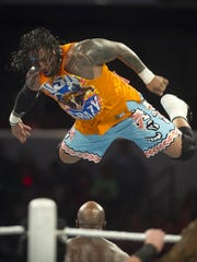 Jimmy Uso, of The Usos, flies off the ropes en route