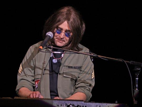 Ron McNeil portrays Beatle Jon Lennon during a performance