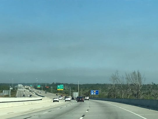 Smoke from a fire in debris mostly from Hurricane Irma