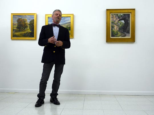 """M. Stephen Doherty of Waynesboro speaks about his plein air paintings at the opening of his exhibition, """"Perceptions of Virginia"""" at the Beverley Street Studio School Gallery Friday, Nov. 13, 2015."""
