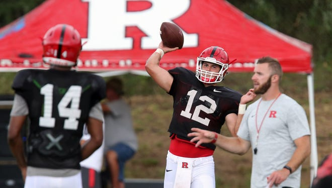 Rutgers football practice continues at the grass field off of Hospital Rd. in Piscataway on Wednesday August 10, 2016.Rutgers quarterback's # 14 (left) Tylin Oden and # 12 (right) Zach Allen work out together during practice.
