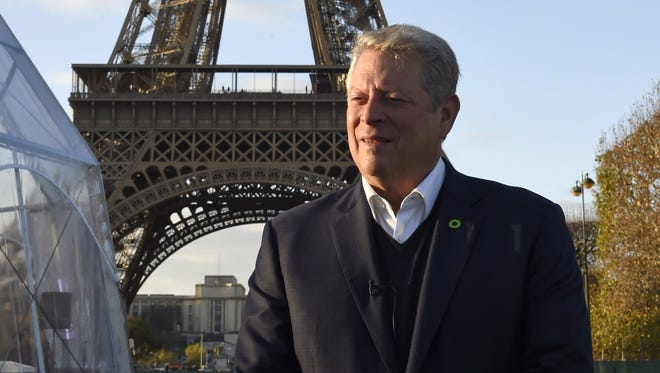 Al Gore speaks during an interview with AFP on November 13, 2015 at the foot of the Eiffel Tower in Paris, ahead of the key United nations conference on climate change scheduled in Paris through November 30 - December 11.