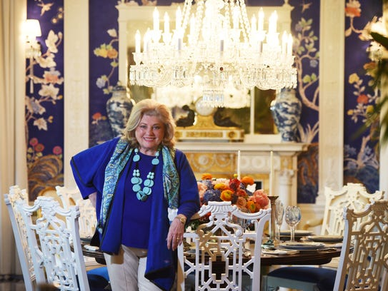 "Barbara Ostrom in her showroom ""Dining at The Abbey."""