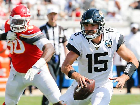 Jacksonville Jaguars QB Gardner Minshew runs from a Kansas City Chiefs defender