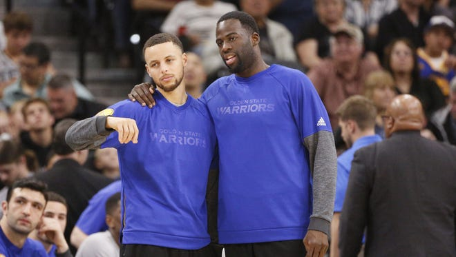 Steph Curry, left, and Draymond Green were among four members of the Golden State Warriors to sit out a recent game vs. San Antonio.