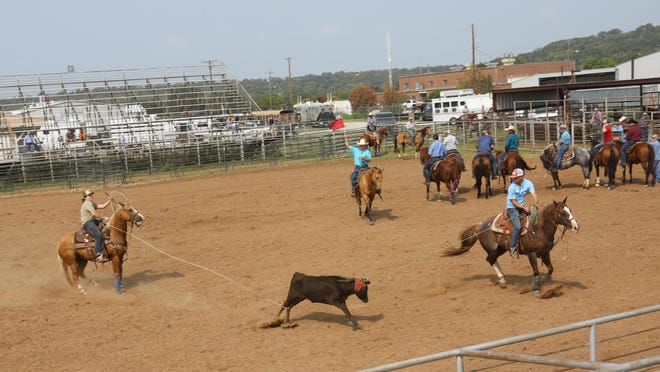 The first-place roping team of Shye Pate and Rowdy Elkins is pictured at the team roping event Saturday.