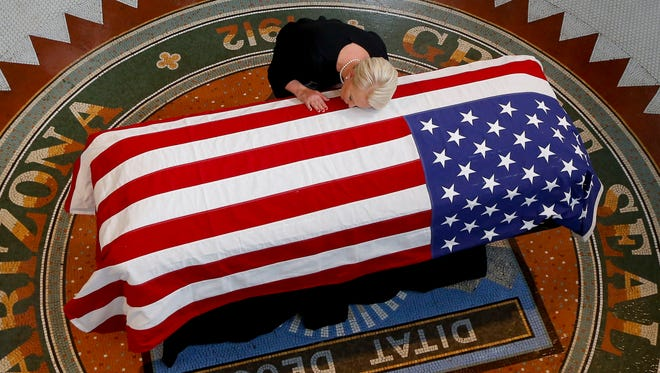 Cindy McCain, wife of Sen. John McCain (R-AZ) touches the casket during his memorial service at the Capitol on Aug. 29, 2018 in Phoenix, Ariz. Sen. McCain, a decorated war hero, died Aug. 25 at the age of 81 after a long battle with Glioblastoma, a form of brain cancer.
