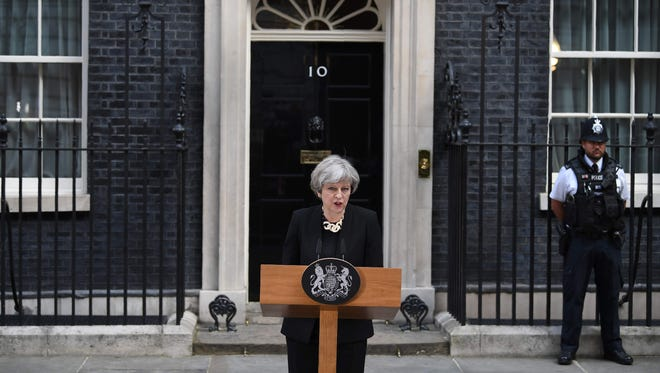 Britain's Prime Minister Theresa May delivers a statement outside 10 Downing Street in central London on June 4, 2017, following the June 3 terror attack. May said tougher Internet regulation was need to prevent terrorist activity online.