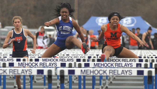 St. Peter's Alysse Wade and Mansfield Senior's Alaya Grose finish second and third in the 100 meter hurdles at the 86th Mehock Relays.