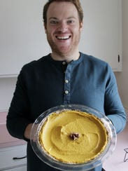 Kyle Griffith shows off the vegan pumpkin pie he made
