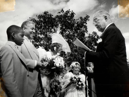 Mayor Coleman Young marries Paul Hubbard, president of New Detroit, and Georgia Redd McDoughle.