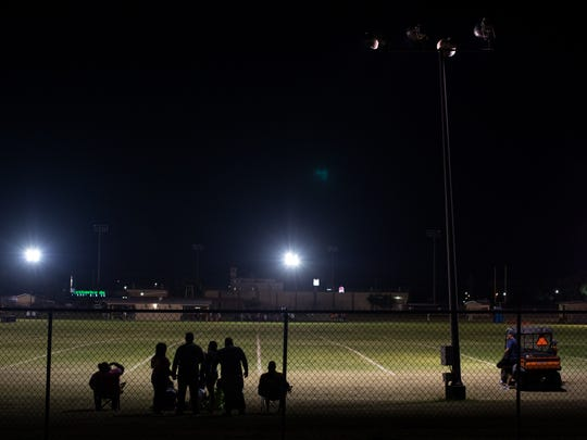 Members of the Alice committee what on the high school practice football field for 12:01am when the team will start their first practice of the 2017 season on Sunday, Aug, 6, 2017.