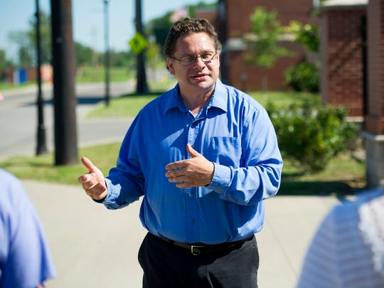 Local historian Frank Nally, of Henderson, walks down Water Street while speaking about the history of the riverfront during a Depot Community Room historical walking tour of downtown Henderson, Saturday, Sept. 3, 2016 Nally has been leading tours for the last decade.