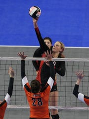 Harlan's Jess Schaben goes up for a spike during the