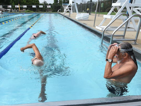 """Jay Strauch, 84, of Mountain Home, left, finishes a lap while Don Pavlik, 74, watches. Pavlik calls Strauch his """"inspiration."""""""