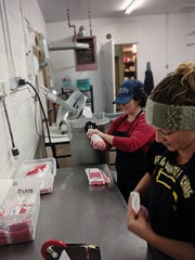 Bear Paw Meats is definitely a family-run endeavor. The Bucks' daughter, Ashley Callahan, left, manages stores in Chinook and Havre. Jenny Buck, right, and her husband Travis also help with the business.