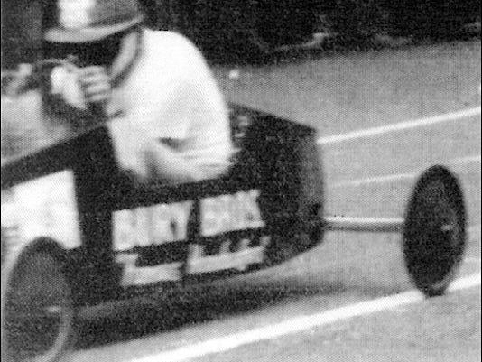 Soap Box car, sponsored by Bury Bros. Famous Hamburgers, wins its heat on the Madison Avenue, York, PA, course in 1951. (Source: York County History Center)
