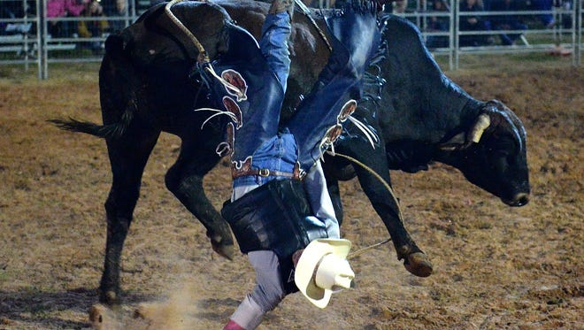 Budd Williamson takes a fall during a PBR bull riding  event in Cunnamulla, Australia, last August.