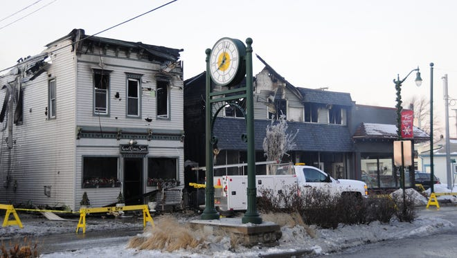 Buildings housing Newport Clippers, 223 Broadway, and Vera Grace Emporium, 229 Broadway, were severely damaged in a fire Friday, Jan. 19, 2018 in Marine City.
