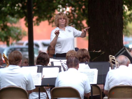 Christie Cochran directs the Coshocton Community Band during a concert on the courtsquare. The group is asking for monetary support from Coshocton City Council with $2,500 for 2018 being one suggested amount.