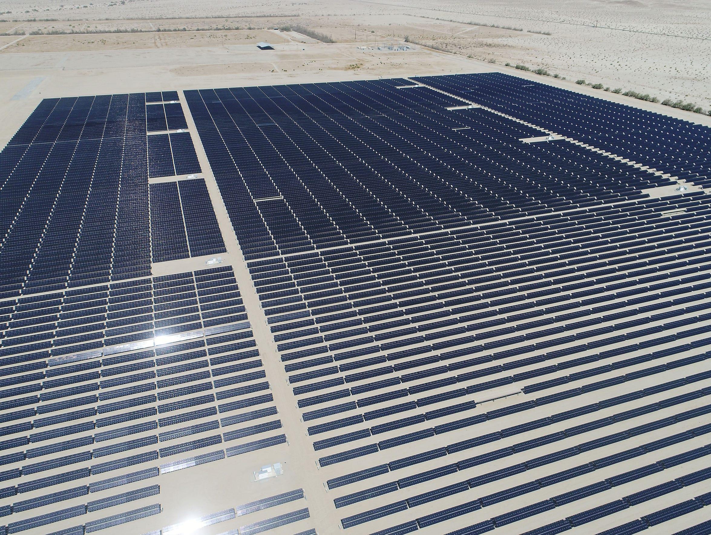 Solar panels generate electricity at the 50-megawatt