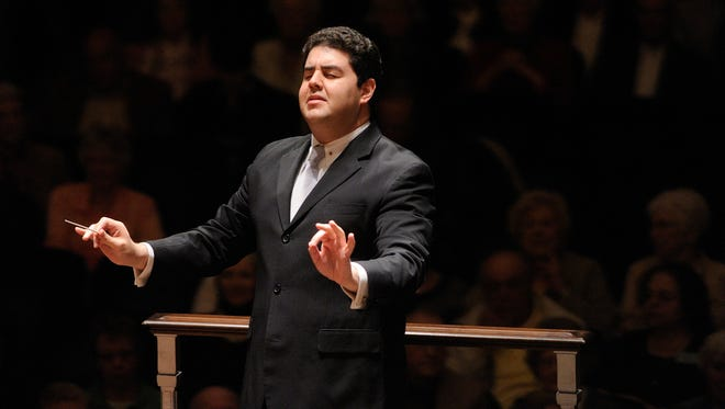 Tito Muñoz conducting the Cleveland Orchestra.