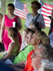 Community members gather for the 18th annual Memorial Day observance at Hollywood Cemetery.