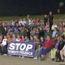 Hundreds march to end domestic violence.