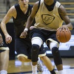 Purdue senior Neal Beshears, shown here guarding teammate Vince Edwards in a preseason scrimmage, says wins are a better reward than playing time.