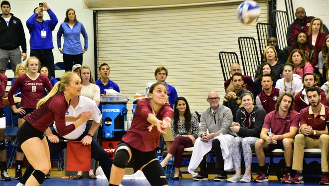 Katie Horton goes for a dig during FSU's match against Florida in the NCAA tournament.