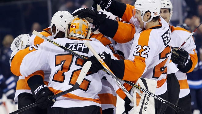 Philadelphia Flyers goalie Rob Zepp (72) celebrates his teams win during the overtime period against the Winnipeg Jets. Zepp, 33, a former Everblades player, is the oldest goalie to win his NHL debut.