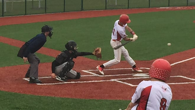Port Clinton's Aidan Rospert swings at a pitch Tuesday at League Park in Cleveland.