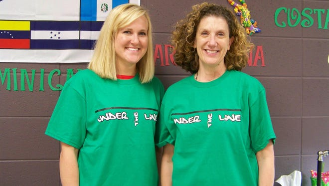 Nixa High School teachers Cheryl Zych, right, and Alicia Martinez support Under the Line by eating on $1.50 per day, mimicking the amount children living in extreme poverty have for food in the United States.