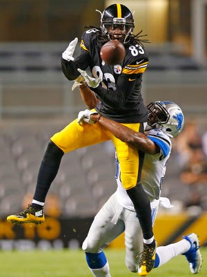 Detroit Lions cornerback Alex Carter, bottom, breaks up a pass intended for Pittsburgh Steelers receiver Canaan Severin during the second half of an NFL exhibition in Pittsburgh, Friday, Aug. 12, 2016.
