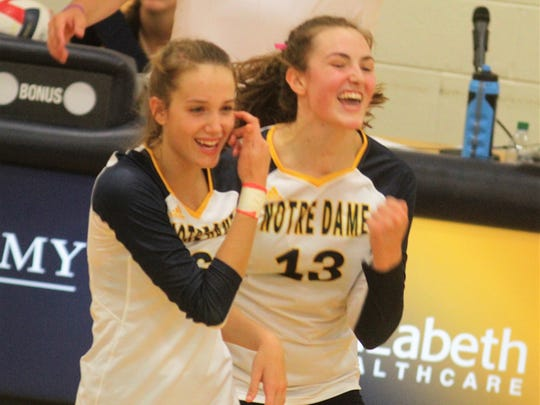 Notre Dame junior Kenley Way, left, and senior Belle Morgan August 16, 2018 as Notre Dame beat Cooper 3-1 in volleyball.