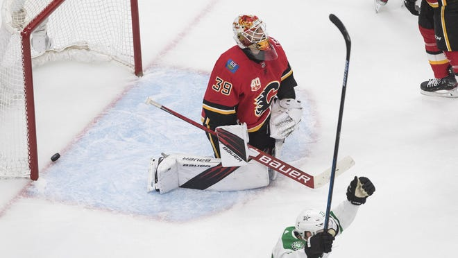 Calgary Flames goalie Cam Talbot (39) reacts after giving up a goal, as Dallas Stars' Esa Lindell (23) celebrates during overtime in Game 4 of an NHL hockey first-round playoff series, Sunday, Aug. 16, 2020, in Edmonton, Alberta.