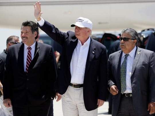 Republican presidential hopeful Donald Trump arrives for a visit to the U.S. Mexico border in Laredo, Texas, on July 23, 2015.