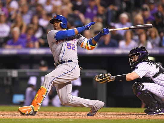 Mets left fielder Yoenis Cespedes connects for an RBI