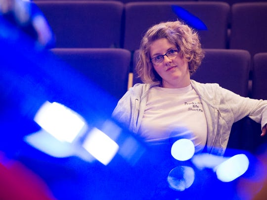 """Director Kensington Eck, of Evansville, watches a scene during rehearsal for Think Pink's """"Hands on a Hardbody"""" at Studio 321 in Evansville."""