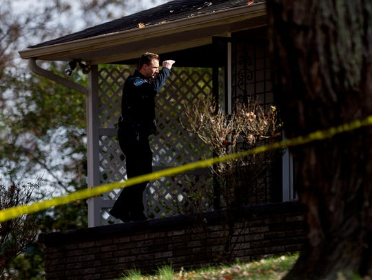A KPD officer investigates at the scene of a non-fatal